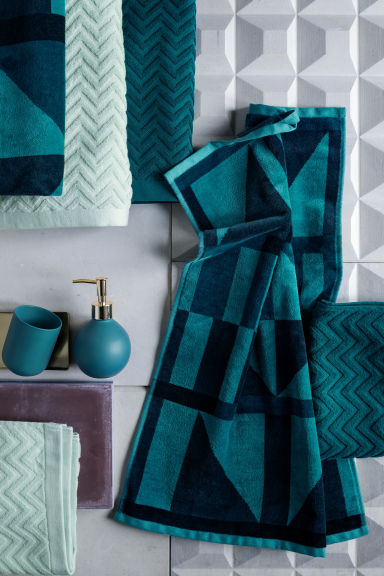 eponge-serviette-bain-bleu-vert-petrole-hm