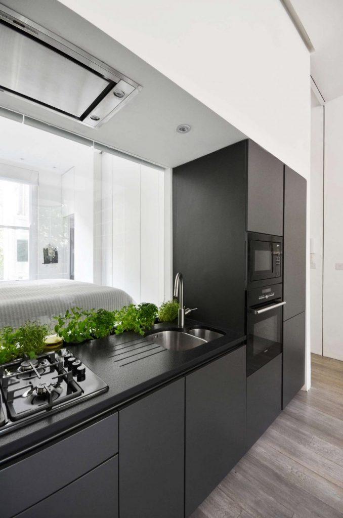 La Hotte Aspirante Est Invisible Cachée Dans Le Meuble Cuisine - Hotte de cuisine plafond